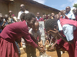Students with a new well in Kenya